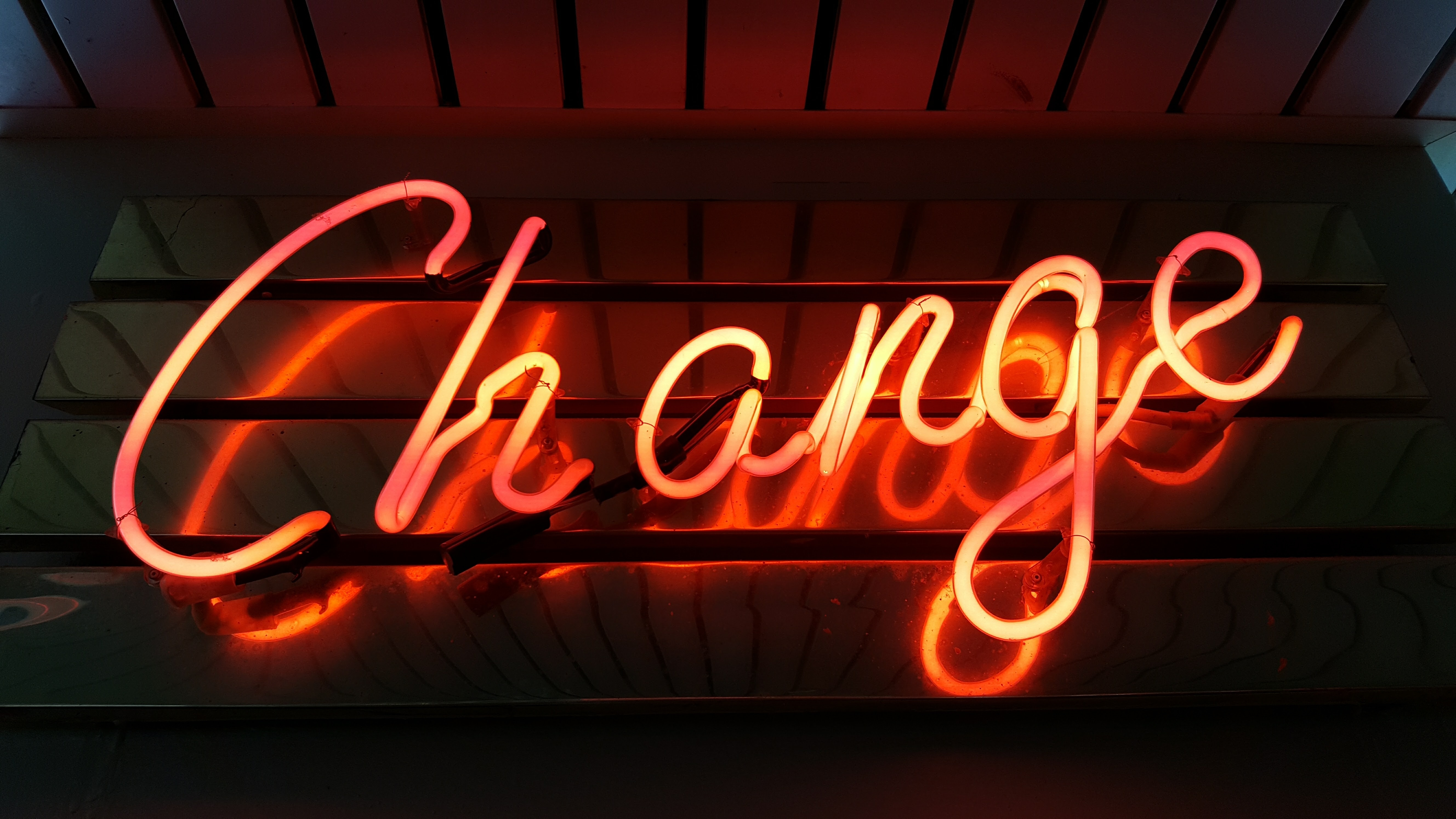 "Neon light up ""Change' sign."