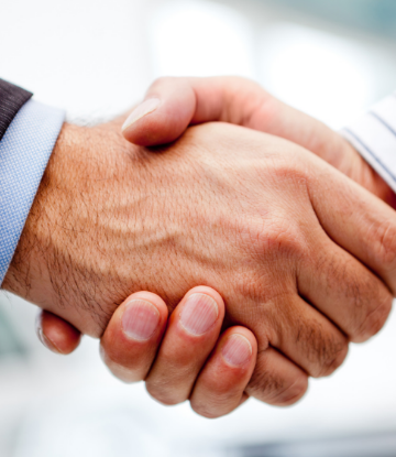 Supply Chain Scene, image of 2 business people shaking hands on a deal