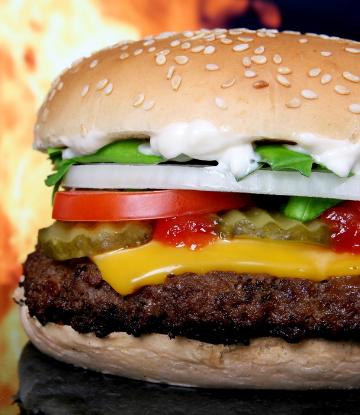 Supply Chain Scene, image of a cooked, delicious, cheeseburger with everything