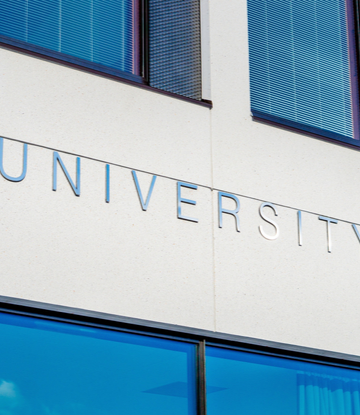 "Supply Chain Scene, image of a building front engraved ""University"""