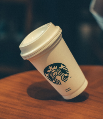 SCS, image of a starbucks coffee cup with lid and logo