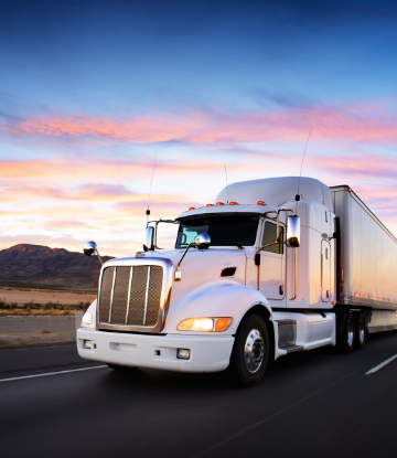 SCS, image of an 18-wheeler reefer at sunset on the highway