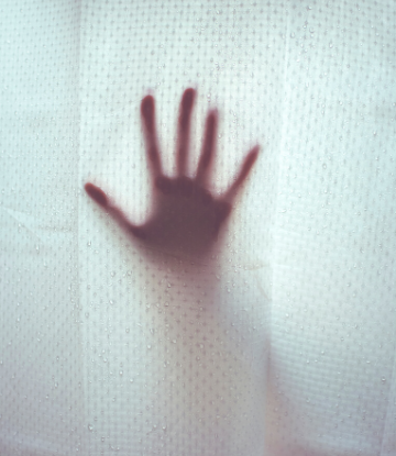 SCS, ghostly image of a hand against a clear shower curtain