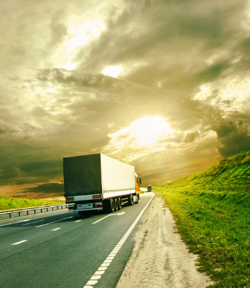 SCS, image of a large truck on the highway at sunset