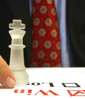 "Image of a chess piece on top of check boxes marked ""win"" or ""lose"""