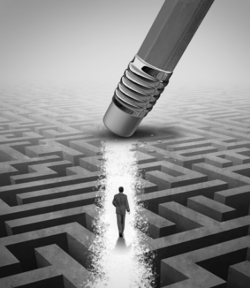 Image of a man walking through a maze with an earaser clearing his path
