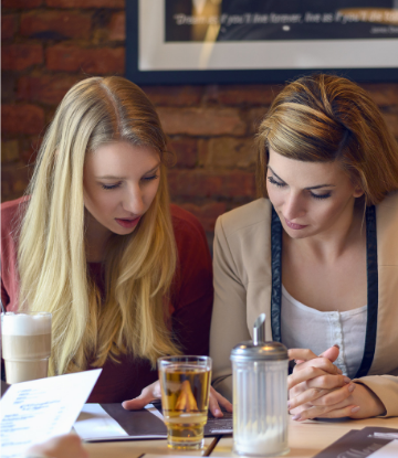 Supply Chain Scene, image of women in restaurant looking at menu