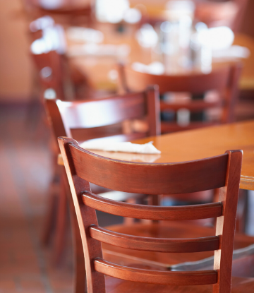 SCS image of an empty chair at an empty table in a restaurant