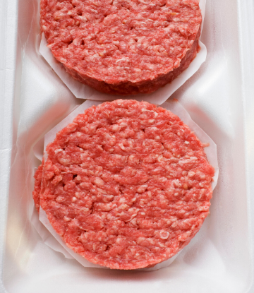 SCSm image of pre-formed hamburger patties in a foam tray