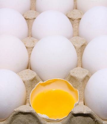 SCS, image of whole fresh eggs with one broken in half showing the yolk