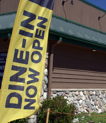 SCS, image of a restaurant with a banner that reads DINE-IN NOW OPEN