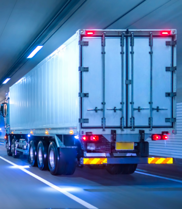 image of a truck driving through a highway tunnel