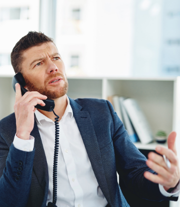 Image of an annoyed business person on the phone