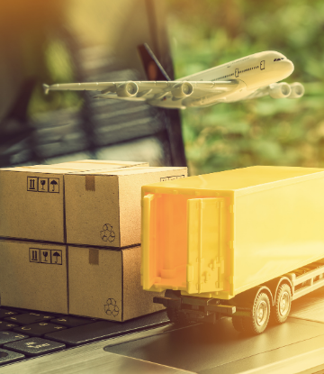 Image of a truck, airplane and product boxes superimposed over a laptop computer