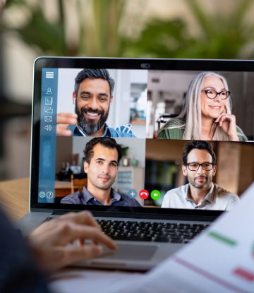 Image of a video conference call with 4 people on a laptop