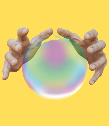 hands around a crystal ball on a yellow background
