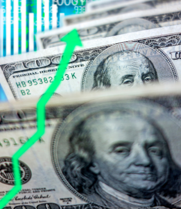 image of $100 bills with a green arrow pointing upward