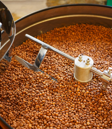 Image of coffee beans in a roaster